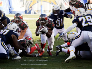 Tampa Bay Buccaneers running back Doug Martin scores during the first half of an NFL football game against the San Diego Chargers Sunday, Dec. 4, 2016, in San Diego. (AP Photo/Denis Poroy)